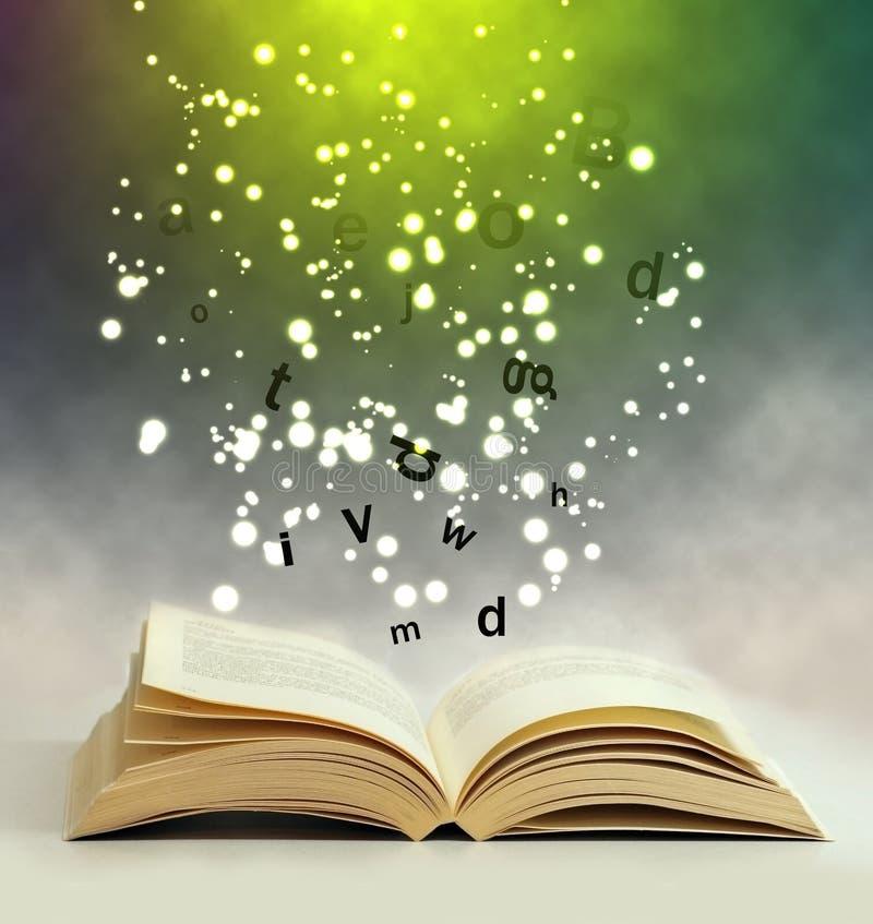 Magic book. Open magic book sparkling light stock photos