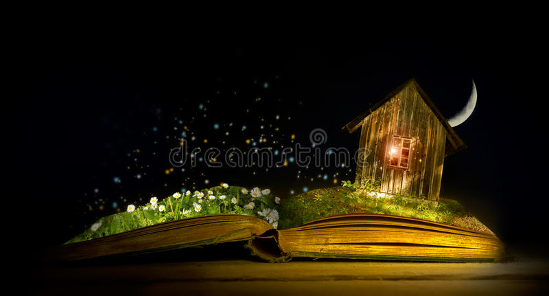 Magic book. With elfhouse and field royalty free stock photos