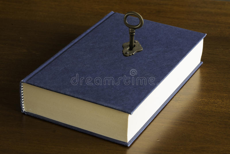 Magic book. The key to the magic book stock images