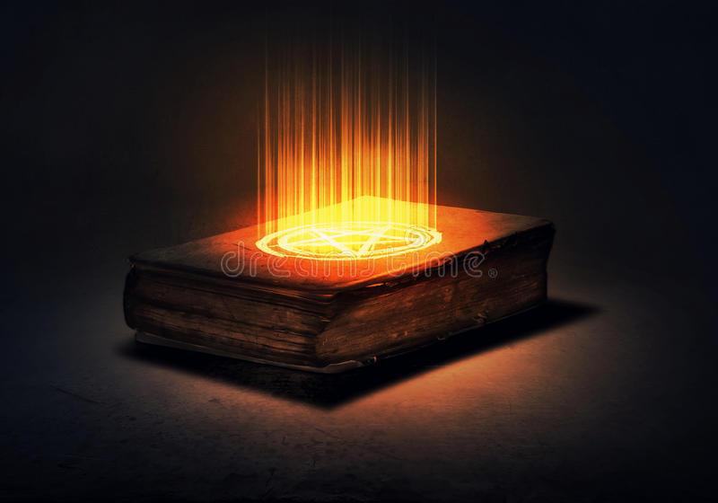 Magic book. Old black magic book with lights on pages stock photography