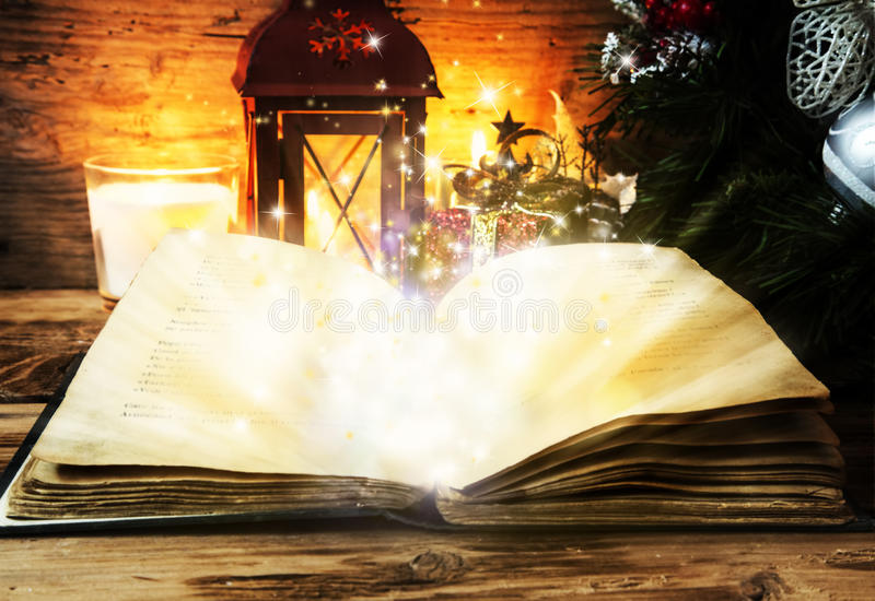 Magic Book. Old Magic Book on Wooden Board and Decorations Background stock images