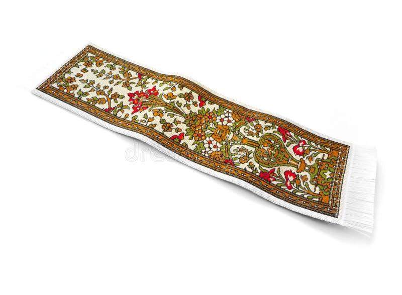 Magic carpet isolated on white royalty free stock images