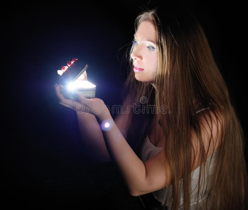 Magic casket. Young woman opening the magic casket royalty free stock photography