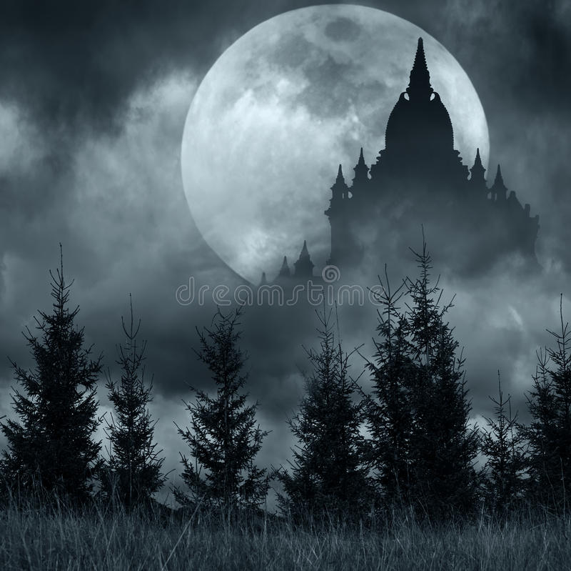 Magic castle silhouette over full moon at mysterious night stock image