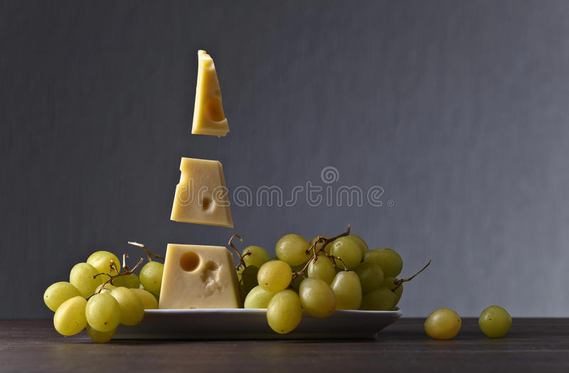 Magic cheese with grape royalty free stock photography