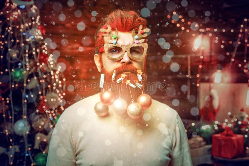 Magic Christmas bokeh - crazy man. Christmas beard decorations. Merry Christmas and happy new year greeting card. Christmas Celebration holiday stock photo
