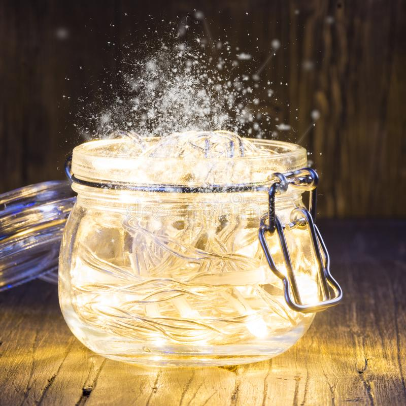Magic Christmas garland with bright lights inside a glass jar stock photography