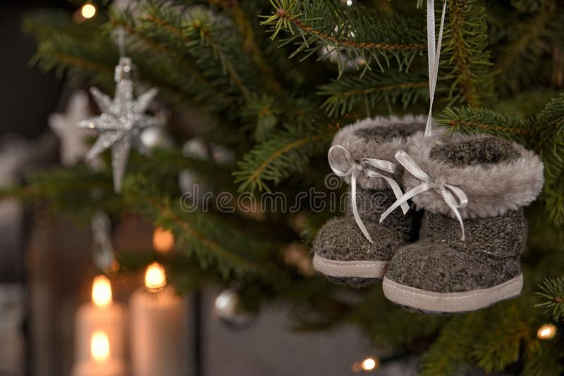 Magic Christmas tree decorated with beautiful gray boots toy and other silver toys. Nice composition and copy space on the background royalty free stock photo