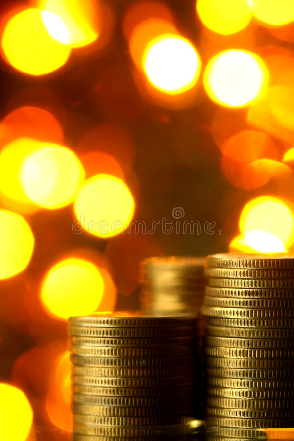 Magic coins. On bokeh background royalty free stock image