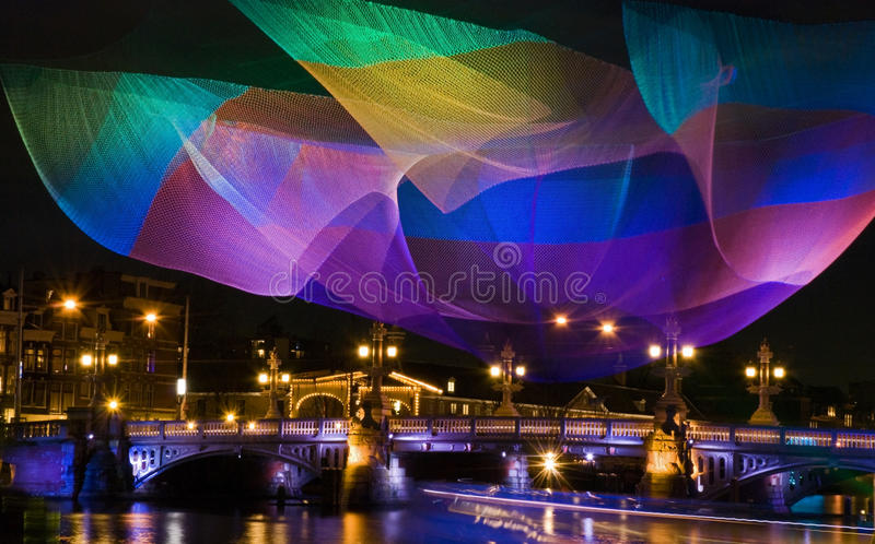 Magic colors Amsterdam. Magic colors at light festival in Amsterdamn 7 December 2012 till 20 January 2013: lluminated fishing net, the 1.26 Amsterdam above the royalty free stock image