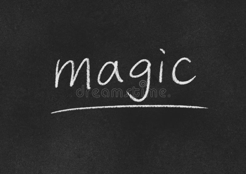 Magic. Concept word on a blackboard background stock image