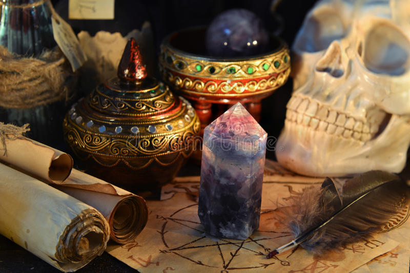 Magic crystal with scull and parchment scrolls royalty free stock image