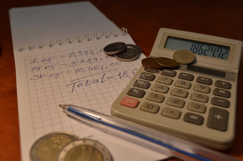 Magic of Digits. Electronic, Written Ones and Money. The simple macro shooting of the calculator, calculations, pen and money of different countries. Ideal for royalty free stock photo