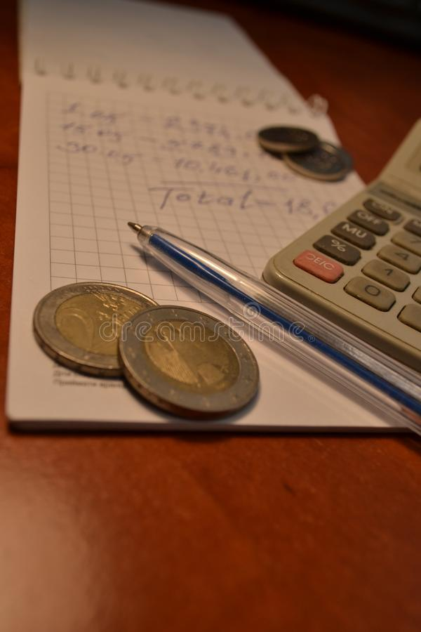 Magic of Digits. Electronic, Written Ones and Money. The simple macro shooting of the calculator, calculations, pen and money of different countries. Ideal for stock image
