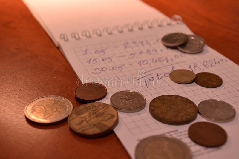 Magic of Digits. Electronic, Written Ones and Money. The simple macro shooting of the calculator, calculations, pen and money of different countries. Ideal for stock photography