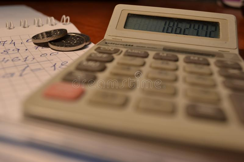 Magic of Digits. Electronic, Written Ones and Money. The simple macro shooting of the calculator, calculations, pen and money of different countries. Ideal for royalty free stock images