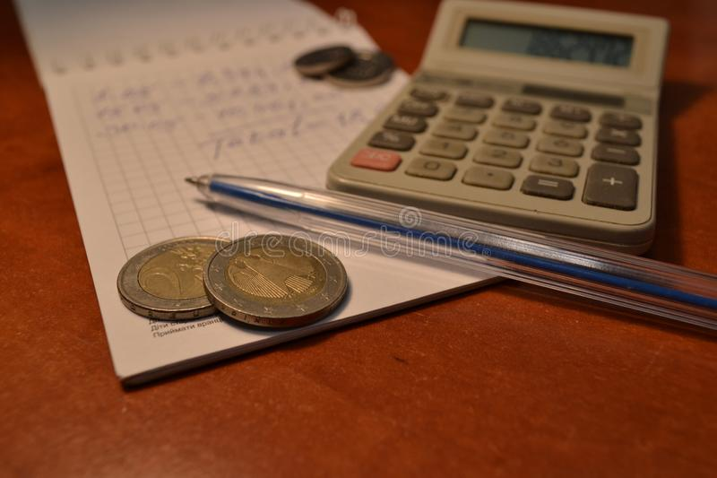 Magic of Digits. Electronic, Written Ones and Money. The simple macro shooting of the calculator, calculations, pen and money of different countries. Ideal for royalty free stock photos