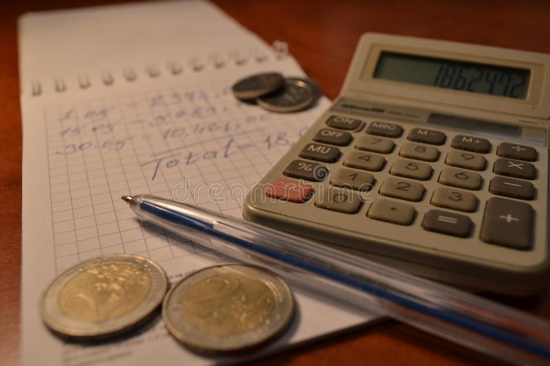 Magic of Digits. Electronic, Written Ones and Money. The simple macro shooting of the calculator, calculations, pen and money of different countries. Ideal for royalty free stock image