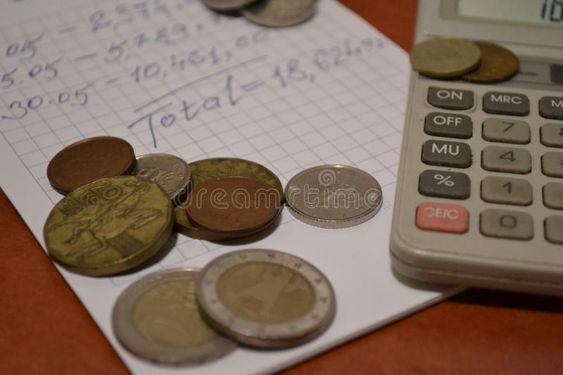Magic of Digits. Electronic, Written Ones and Money. The simple macro shooting of the calculator, calculations, pen and money of different countries. Ideal for stock photos