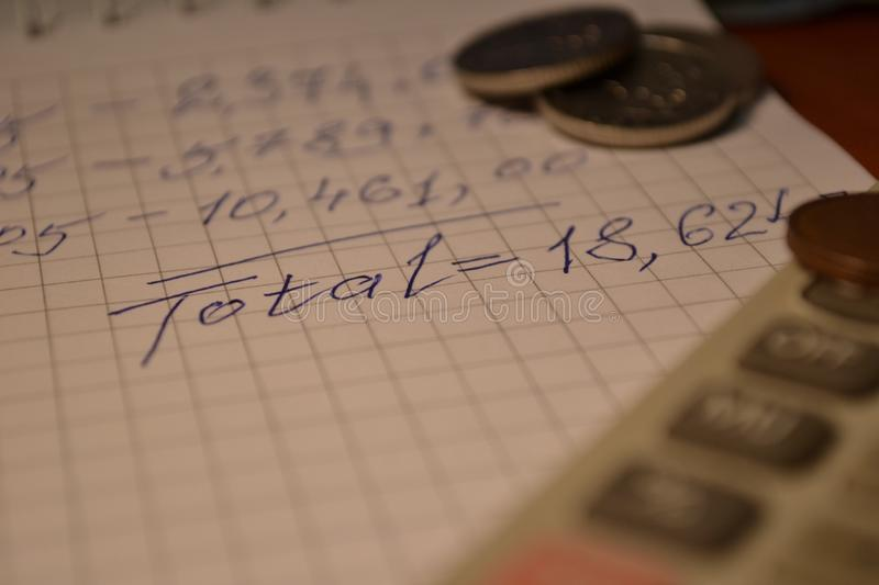 Magic of Digits. Written Ones and Money. The simple macro shooting of the calculations and money of different countries. Ideal for website backgrounds royalty free stock images