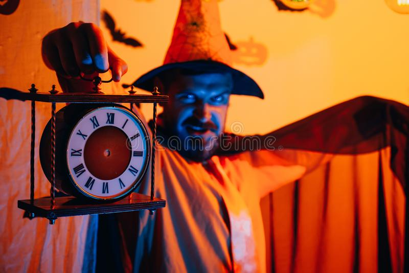 Magic, enchantment and witchcraft. Scary face man with horror Make up holding Pumpkin head jack lantern on sky stock photo