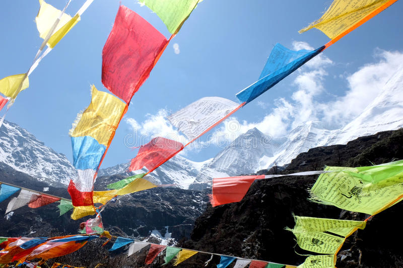 Magic flags among the trail to The Milk Lake at Yading Nature Reserved, China royalty free stock photography