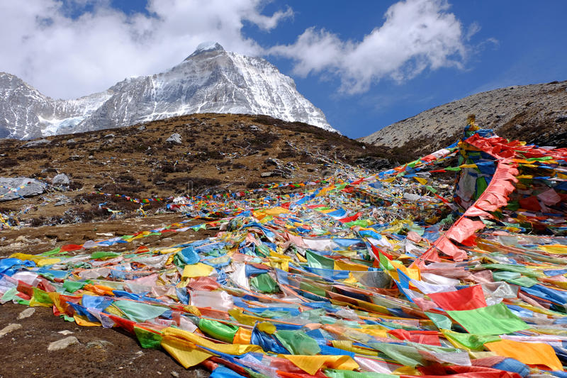 Magic flags among the trail to The Milk Lake at Yading Nature Reserved, China stock image