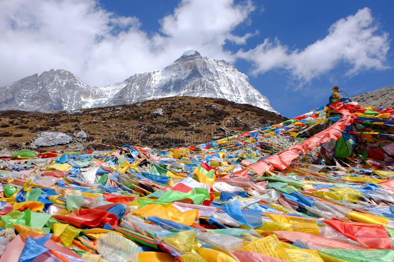 Magic flags among the trail to The Milk Lake at Yading Nature Reserved, China stock images