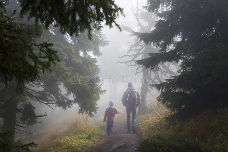 Magic forest walk. Father and child walking through a magic misty forest