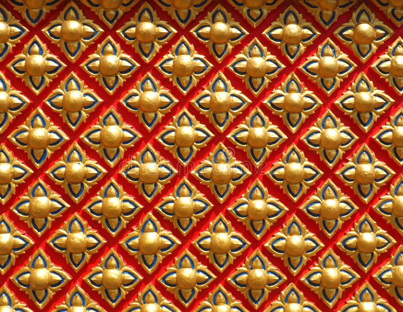 The magic of geometry at a Buddhist temple. Buddhist temple wall close up, geometrical shapes and symmetry