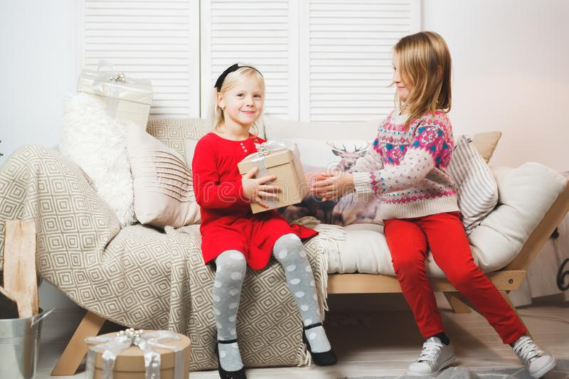 Magic gift box and a child baby girls, Christmas miracle, little beautiful happy smiling girl opens a box with gifts royalty free stock images