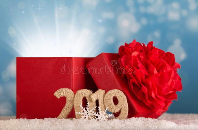Magic gift of magic and the inscription 2019 new year in the snow on blue background royalty free stock photos