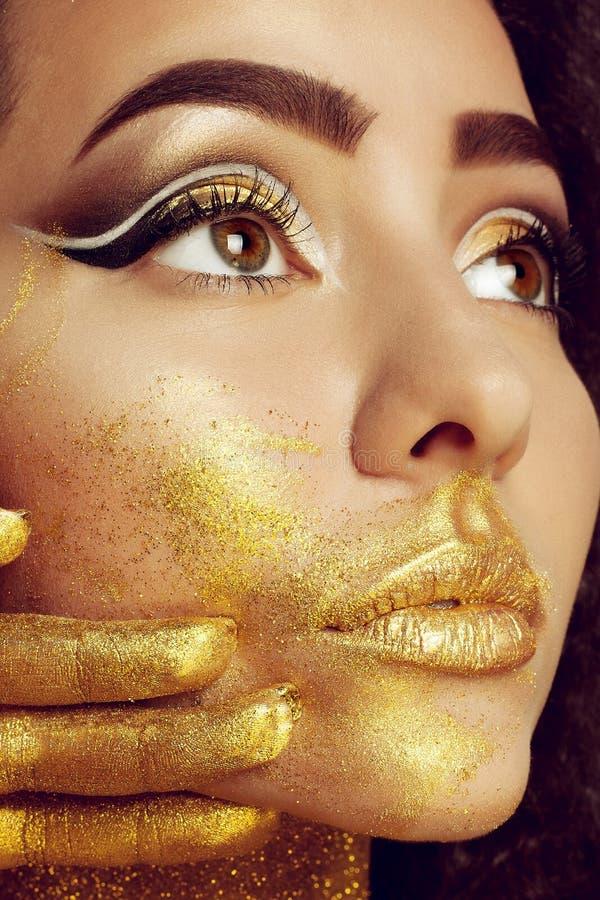 Magic Girl Portrait in Gold. Golden Makeup stock photo