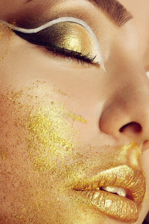 Magic Girl Portrait in Gold. Golden Makeup stock photos