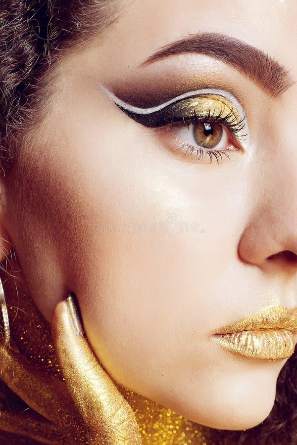 Magic Girl Portrait in Gold. Golden Makeup royalty free stock photos