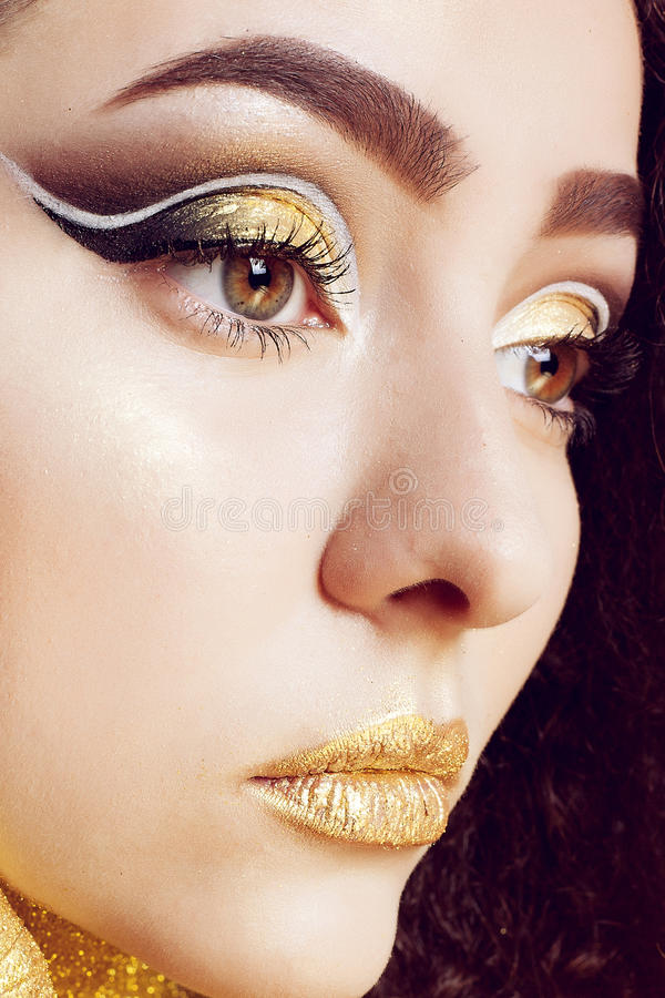 Magic Girl Portrait in Gold. Golden Makeup royalty free stock images