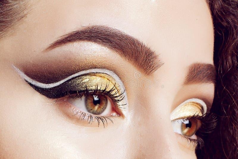 Magic Girl Portrait in Gold. Golden Makeup stock image
