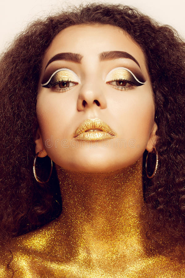 Magic Girl Portrait in Gold. Golden Makeup royalty free stock photo