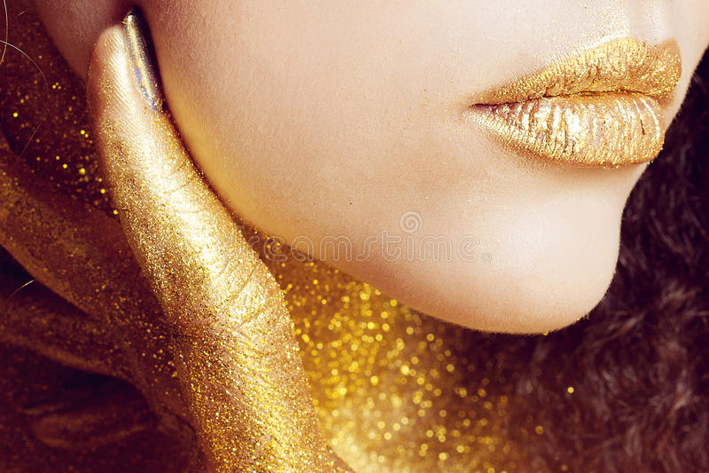 Magic Girl Portrait in Gold. Golden Makeup stock photography