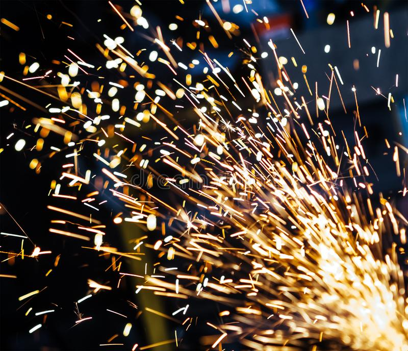 Magic glowing Flow of Sparks in the Dark background. royalty free stock images
