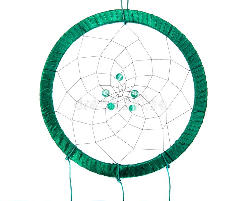 Magic green dream catcher with feathers isolated on the white. Dreamcatcher american native indian traditional decoration background symbol photo culture circle stock image