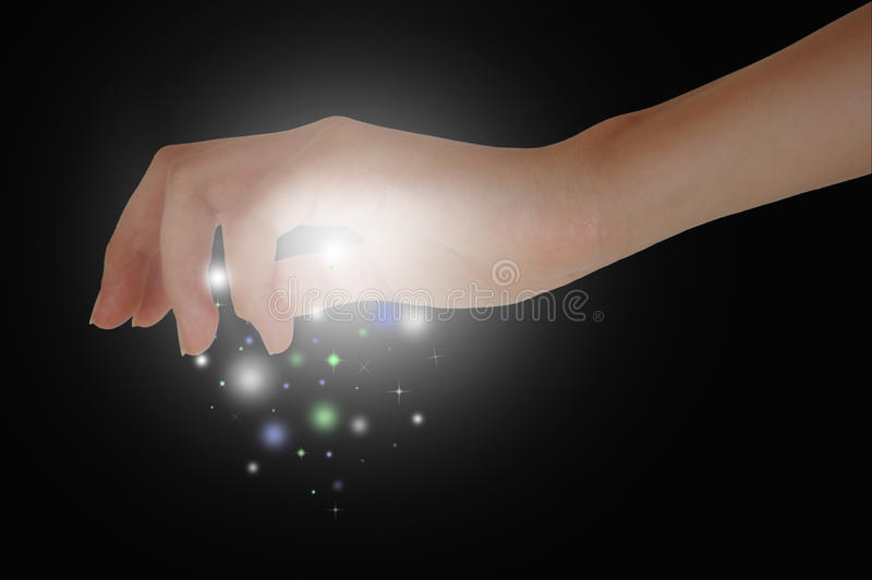 Magic Hand. A hand releasing magic dust stock photography