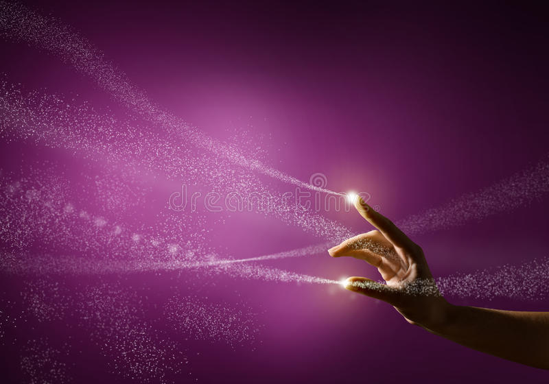 Magic hand. Conceptual image with glow on a colored background stock images