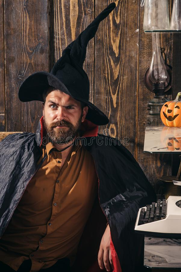 31 october. Make up and scary concept for man. Celebration party. Funny wise wizard on a Halloween background. Wizard stock image