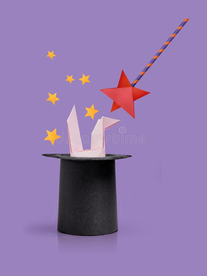 Magic wand with rabbit ears in cylinder hat royalty free stock images