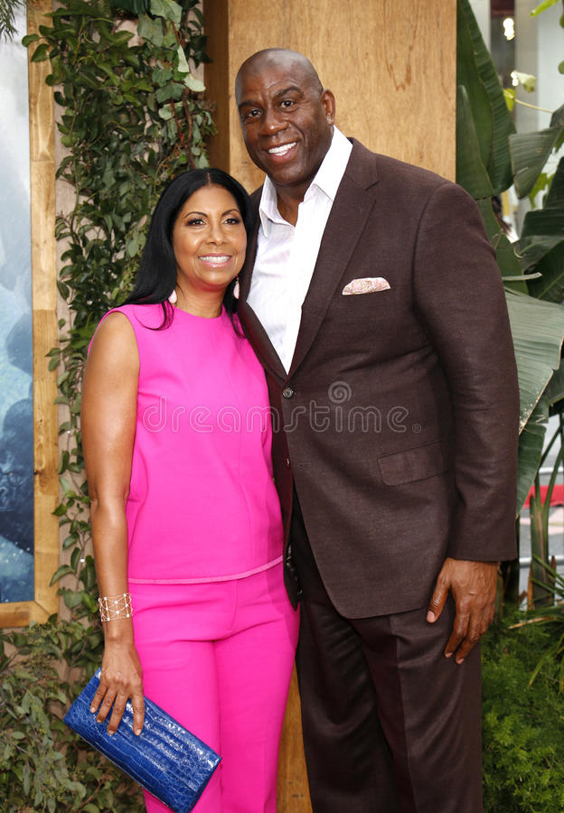 Magic Johnson and Cookie Johnson. At the Los Angeles premiere of 'The Legend Of Tarzan' held at the Dolby Theatre in Hollywood, USA on June 27, 2016 stock photos