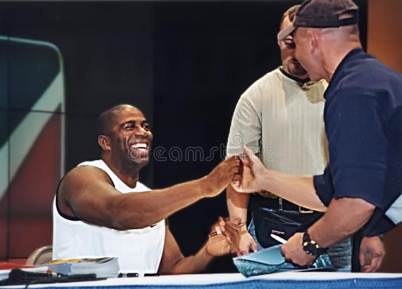 Magic Johnson. Earvin `Magic` Johnson, is caught as he signs autographs in Las Vegas, Nevada on October 23, 1999. Johnson was a Michigan State All-American who royalty free stock photos
