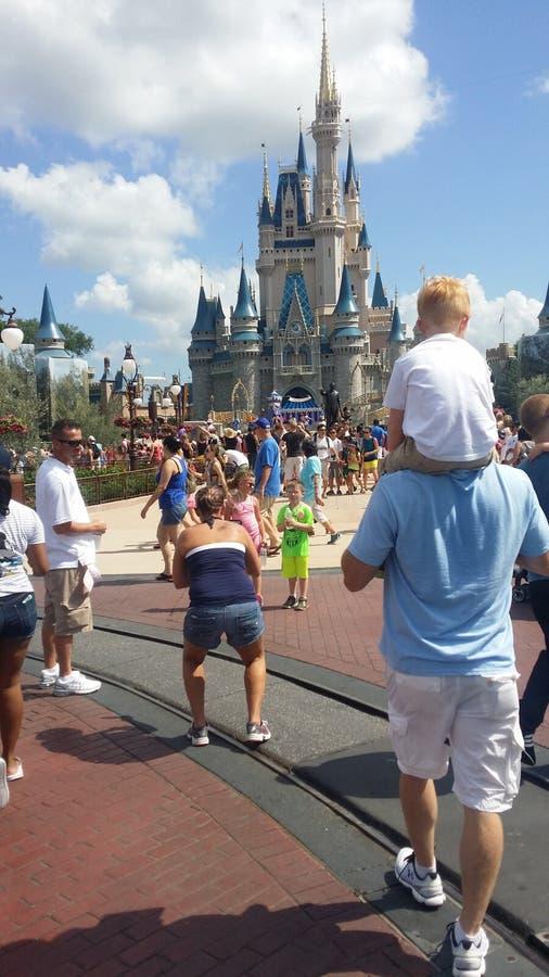 Magic Kingdom. My son on my husband's shoulders in Disney World stock photography