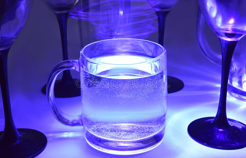 Magic mineral water in glasses stock photos