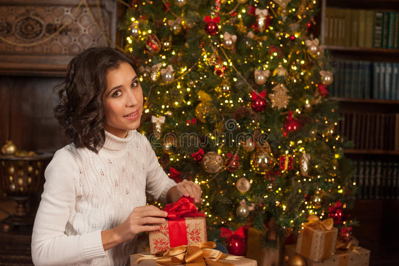 Magic moment of Christmas. Girl opens surprise gift for Christmas royalty free stock photos